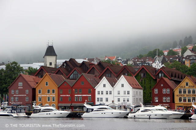 Colourful houses and yachts in Unesco listed Bryggen in Bergen in Norway.
