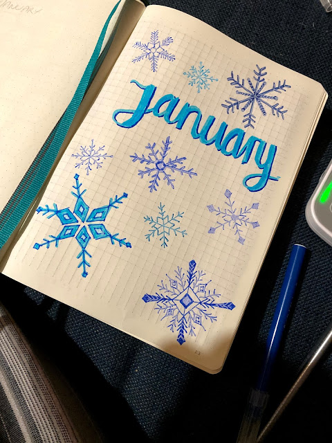 January title page in a bullet journal with hand drawn blue snowflakes