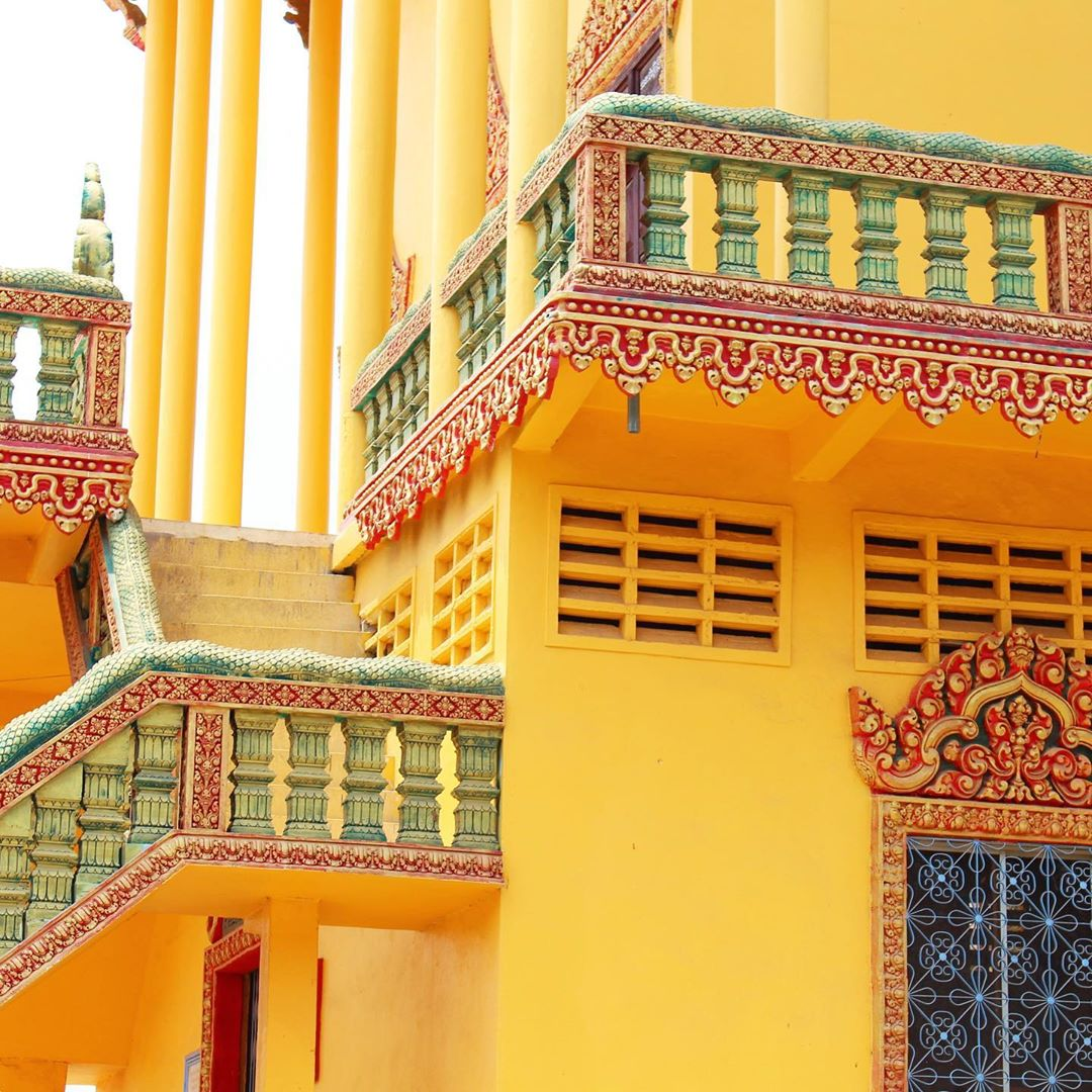 Ornate colourful yellow building in Phnom Penh, Cambodia - travel and lifestyle blog