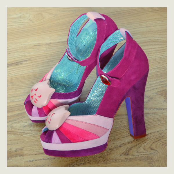 Irregular Choice Kitty Princess shoes in pink sitting on floor