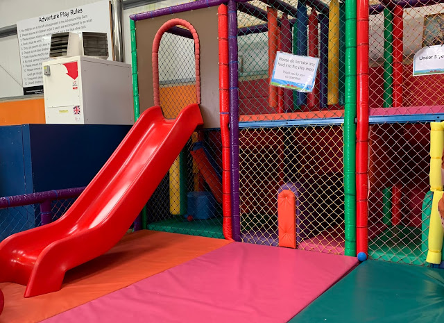 Younger children's soft play area at Barleylands with a red slide and padding visible