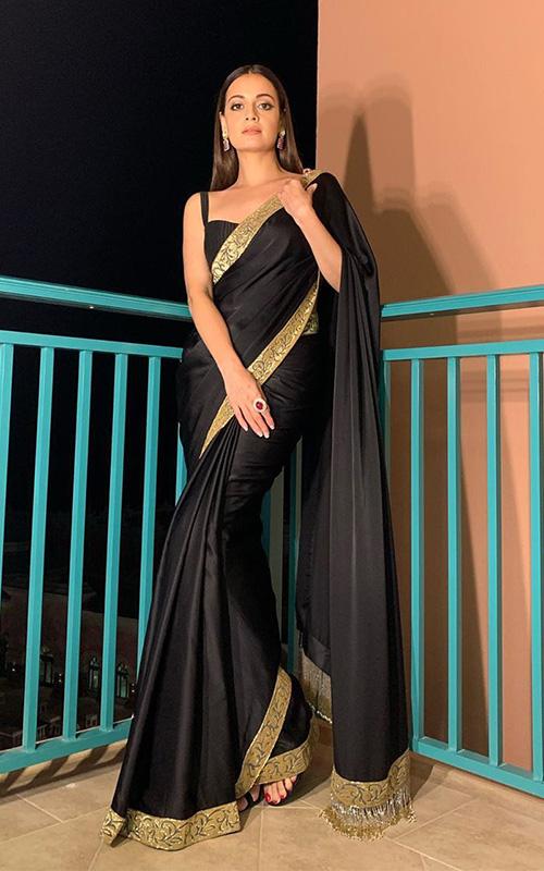 Dia Mirza wearing a black saree