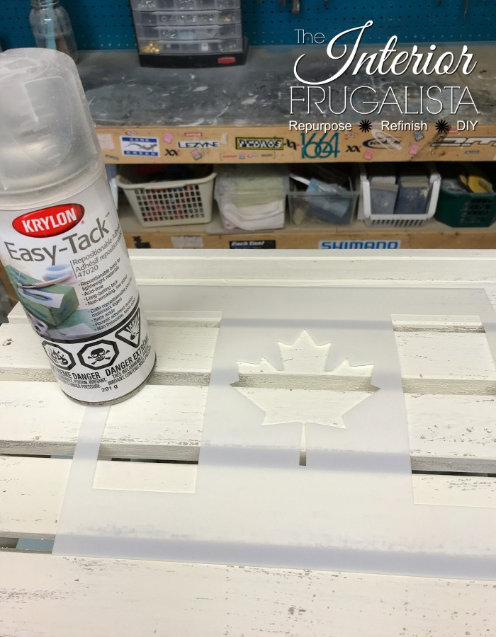 Sign for Canada Day, an easy patriotic craft idea using an upcycled dollar store wood plank and Canadian flag stencil.