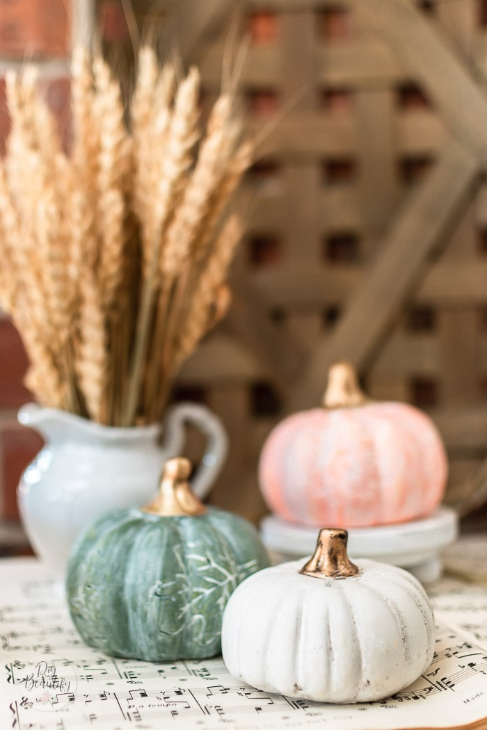 white waxed pumpkins with gold toned stems