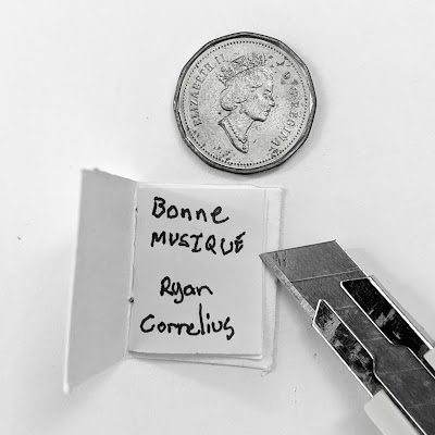 Bonne Musique Artist Book - Inside cover with a Canadian penny for scale.