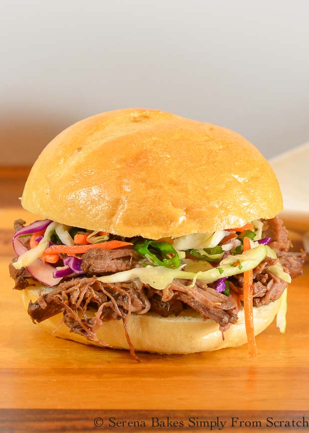 Slow Cooked Korean Pulled Beef Sliders. Tender shredded Korean Pulled Beef piled high on a warm bun and topped with Asian Coleslaw from Serena Bakes Simply From Scratch.