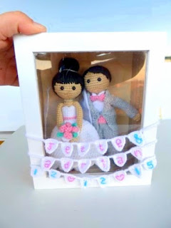 Crochet amigurumi wedding couple in glass box
