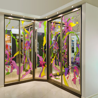 A Mirrored Cabinet With the Color Pattern