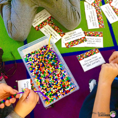 Photo of students working with math task cards and colorful beads.