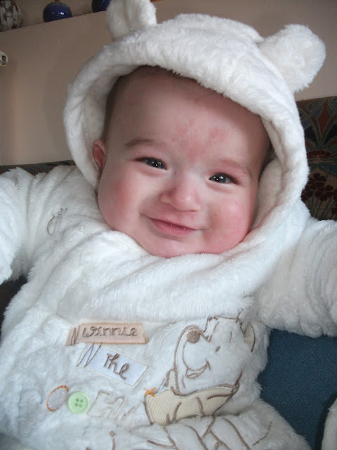 baby wrapped up warm - 6 months old