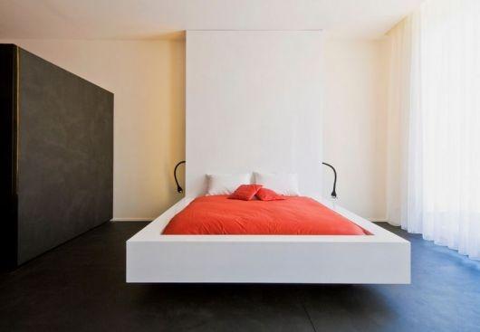 White floating bed with orange sheet