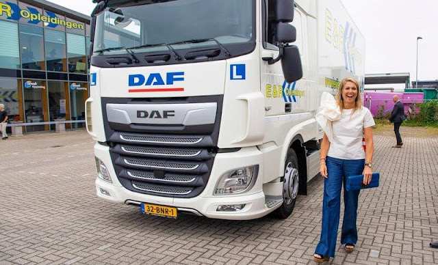 Queen Maxima wore a white silk top from Natan, and navy trousers from Natan. Transport and Logistics sector