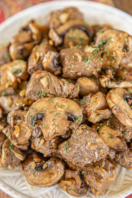 steak tips and mushrooms on a plate