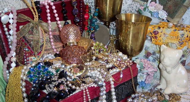 Treasure Chest Filled with Jewels, Necklaces, Golden Cups, and Beads