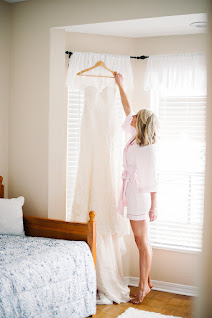 bride reaching for her wedding gown