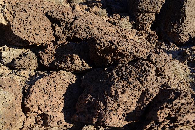 many holed lava rock, but not very sharp