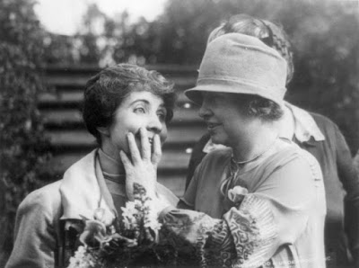 Helen Keller reading the lips of Mrs. Coolidge, the President's wife.