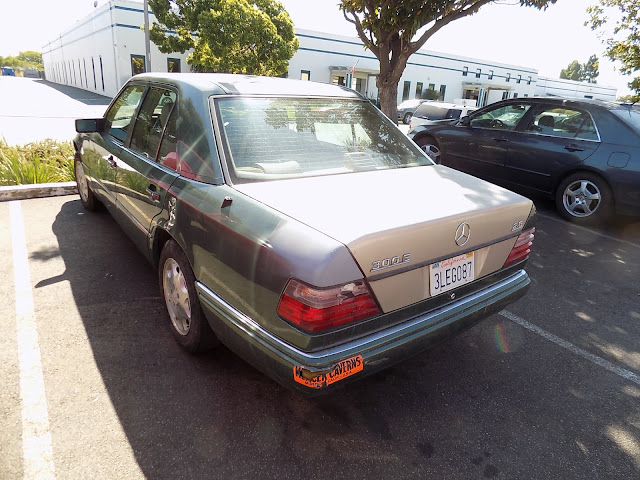 Sad-looking Mercedes Benz before getting complete paint job at Almost Everything Auto Body.