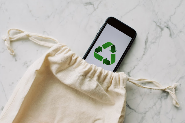 Mobile Phone with Recycling Logo in Cloth Bag