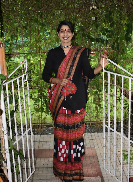 Reshma Kadvath in a saree and an up cycled bag