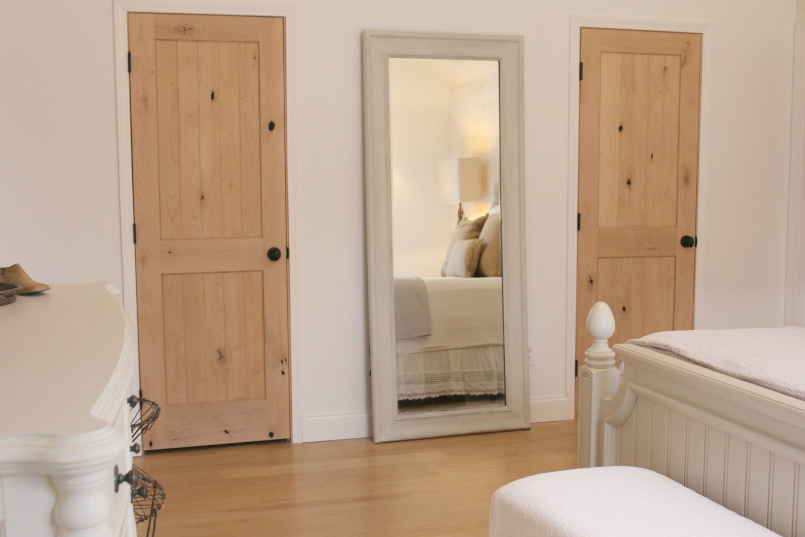 knotty alder doors for his and hers closets in master bedroom of Hello Lovely Studio fixer upper