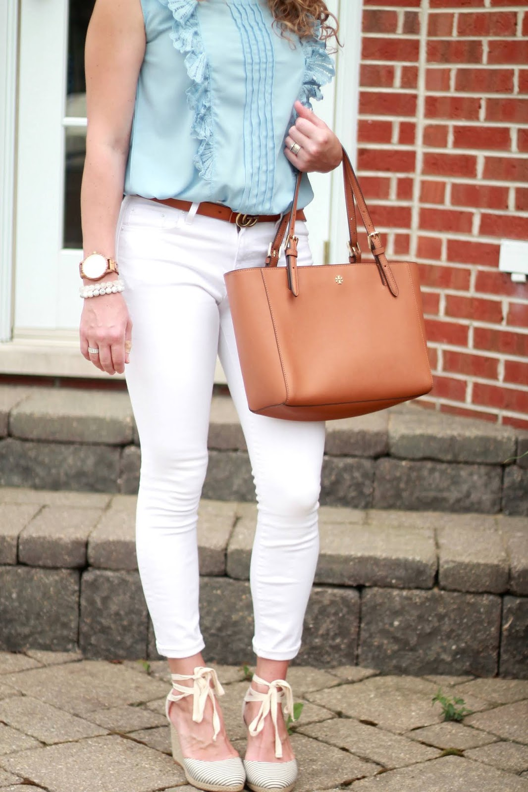 light blue ruffle sleeveless top, white denim, striped espadrilles, tory burch tote