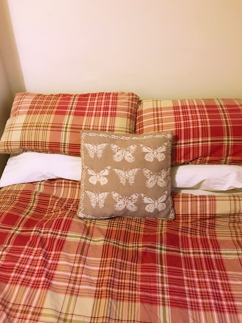 DermaTherapy bedding - bed made up with DermaTherapy pillow cases and checked bedding
