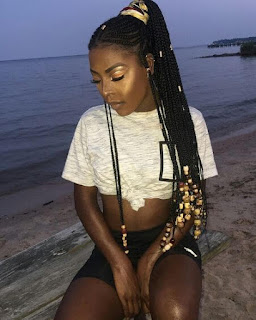 There are loose braids at the front too and also the hair is accessorized with beads 26 Best Tribal Braids Hairstyles Updos 2019 That Attract Beauty
