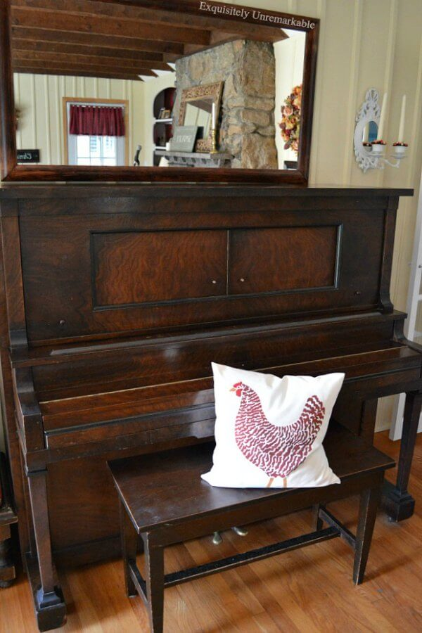 Burl Walnut Antique Player Piano with rooster pillow on bench