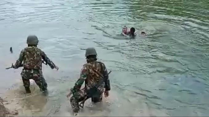 Aksi Heroik, Prajurit Satgas 411 Kostrad Selamatkan Anak Tenggelam Di Sungai