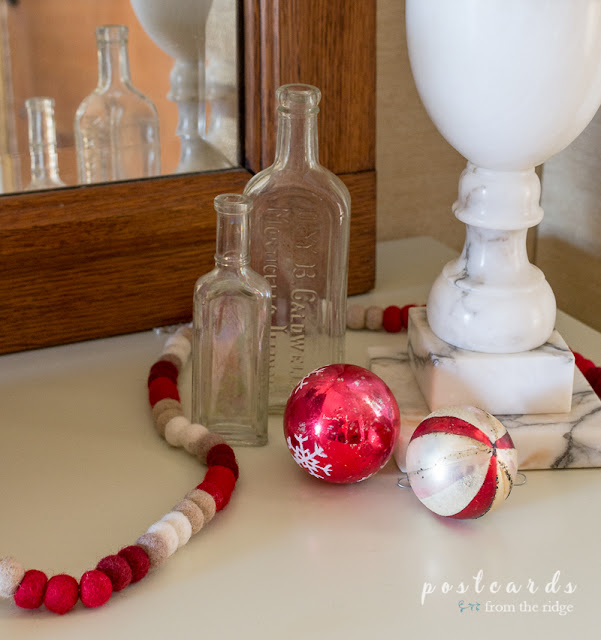 old glass bottles and mercury glass ornaments