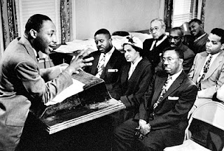 Photo: Martin Luther King (podium) Rosa Parks (center)