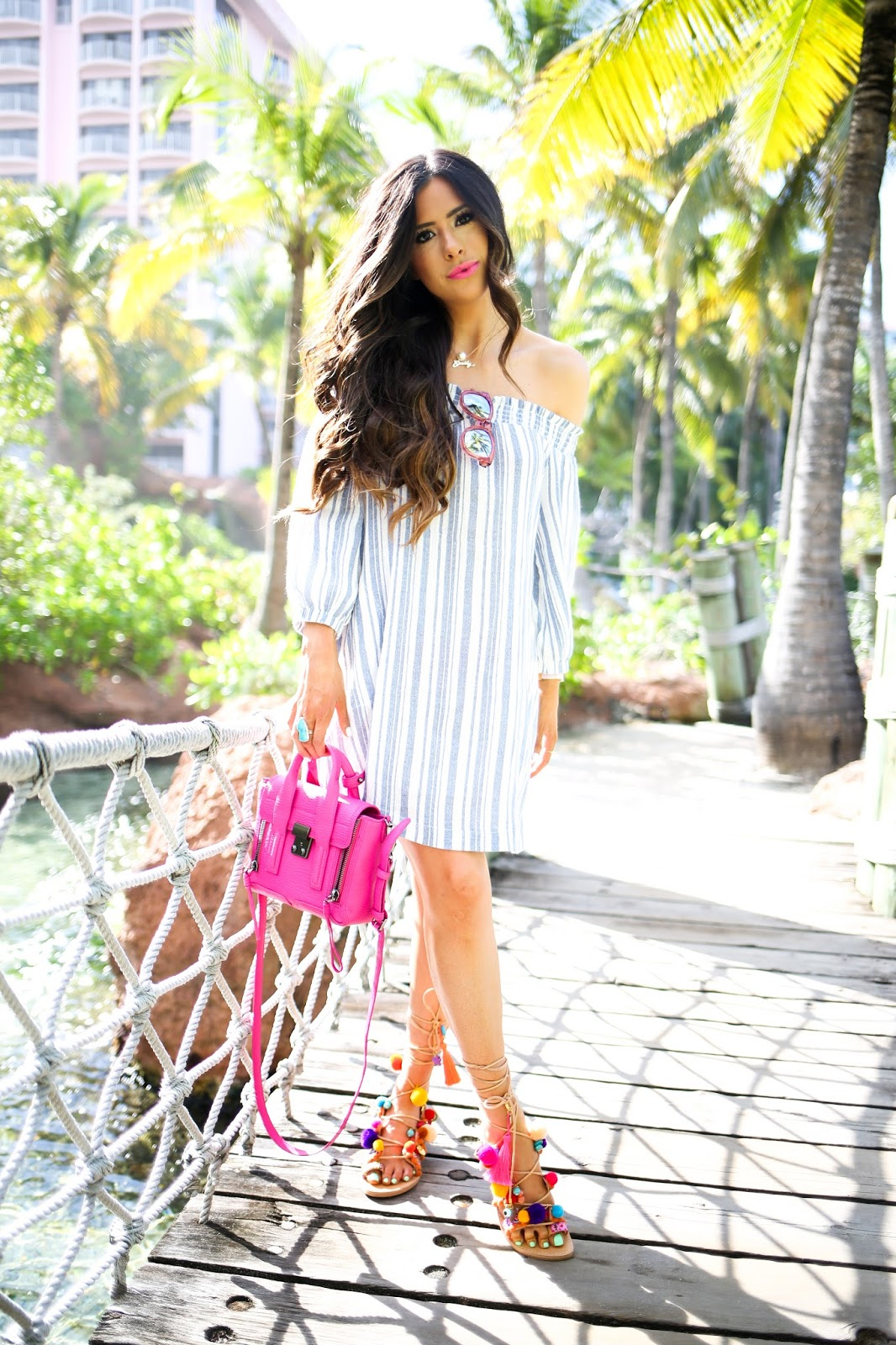 pink mini phillip lim, fuchsia phillip lim mini handbag, lush off the shoulder dress nordstrom, elina linardaski penny lane sandals, gladiator sandals with charms and poms, sandals with poms that tie around ankle, atlantis bahamas fashion blog, emily gemma blog, the sweetest thing blog, how to style a pink handbag during winter, what to do in atlantis bahamas, where to stay in the bahamas, what to wear on spring break, outfit ideas for beach trips, odysssey turquoise ring, pink cross body handbag, nordstrom affordable dresses for spring, brunette bayalage hair, bellami balayage hair extensions