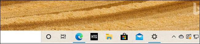 رمز شريط مهام موقع مثبت على Edge لـ How-To Geek على نظام التشغيل Windows 10.