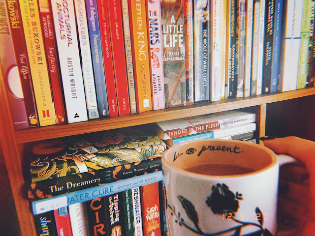 Book shelf with a cup of tea