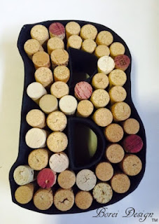 DIY craft tutorial on how to make a recycled monogram wine cork holder display.