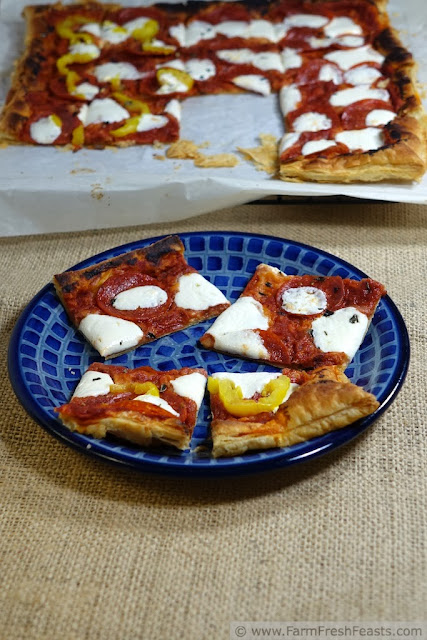 A recipe for pepperoni pizza flavor inexpertly rolled into individual pinwheel pizzas, this makes an easy to eat appetizer.