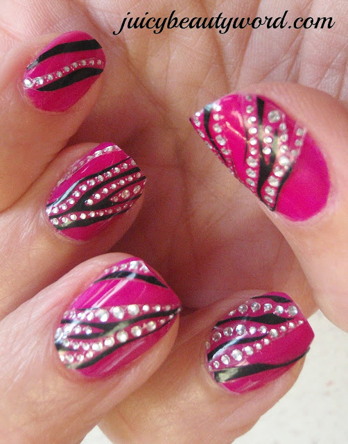 stripy sparkly nail design