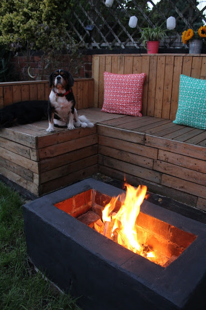 fire pit in garden with seats
