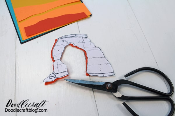 Repeat the process for the other layers of landscape. Finally use the arch as a pattern to cut out the orange paper.