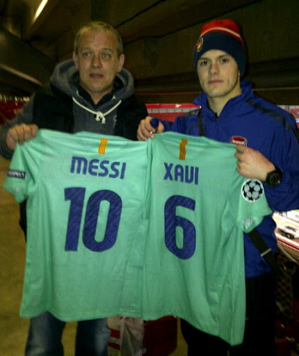 Jack Wilshere posted a picture of him and his dad proudly holding Lionel Messi and Xavi's shirts on his Twitter page