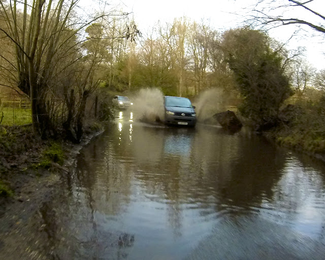 van driving through a huge puddle