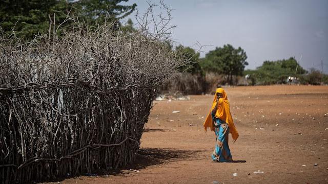 A 17-year-old girl walking in Kenya photo