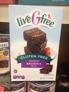 A box of liveGfree Gluten Free Brownie Mix, inside an Aldi store
