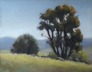 Landscape oil painting of two trees on a hillside.