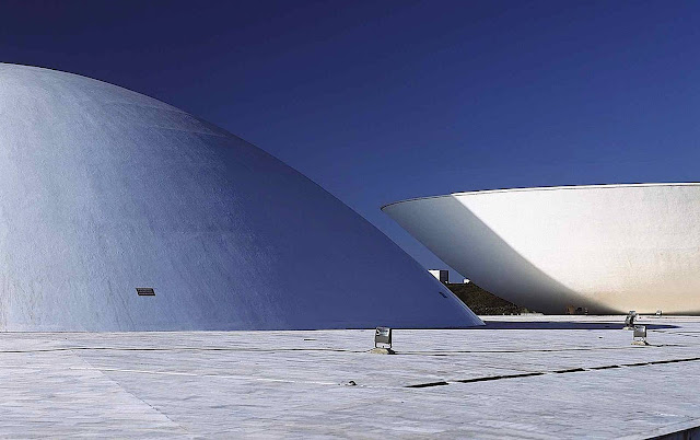 Oscar Niemeyer architecture, a color photograph of white domes
