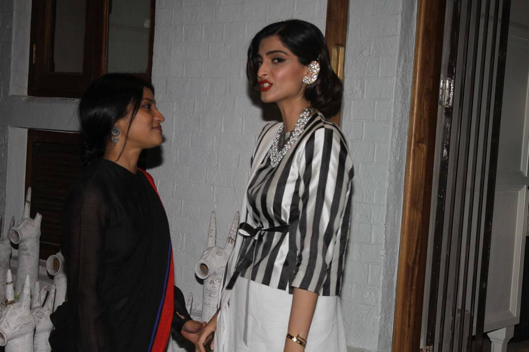 Sonam Kapoor Stills At Store Launch In White Dress