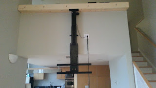 The Whisper Lift II can be mounted to the ceiling or other support for a dropdown TV application.