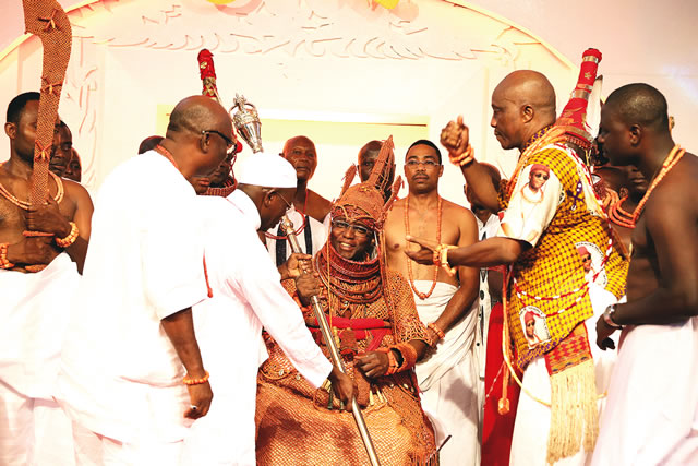 Oba of Benin receives his staff of office from Governor Adams Oshiomole