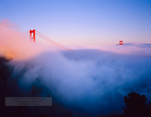 a large format fine art photograph of the golden gate bridge in fog